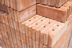Rode baksteenmaterialen voor bouw Stock Fotografie