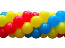 Rode, blauwe en gele vieringsballons in geïsoleerde stapel Stock Afbeelding