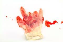 Rode bloeddoorlopen in handschoenhand op witte achtergrond royalty-vrije stock afbeeldingen