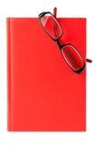 Rode boek en glazen Stock Foto's