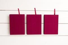 3 rode boeken Stock Afbeelding
