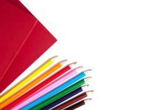 Rode boeken en potloden Stock Foto