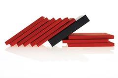 Rode boeken met zwarte  Stock Foto