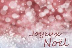 Rode Bokeh-Achtergrond, Sneeuw, Joyeux Noel Mean Merry Christmas Royalty-vrije Stock Afbeeldingen
