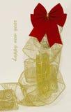 Rode boog met een gouden lint royalty-vrije stock foto's