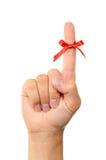 Rode boog op vinger Royalty-vrije Stock Foto's