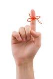 Rode boog op vinger Royalty-vrije Stock Afbeelding