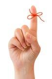Rode boog op vinger Royalty-vrije Stock Afbeeldingen