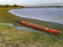 Rode boot de zonsondergang Royalty-vrije Stock Foto
