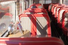 Rode buszetels Stock Afbeelding