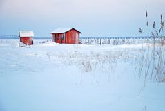 Rode cabines in de winter Royalty-vrije Stock Fotografie