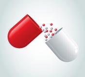 Rode capsule Stock Foto