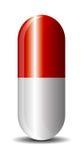 Rode capsule Stock Foto's