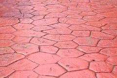 Rode cementbenedenverdieping van een bestrating stock fotografie
