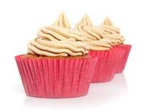 Rode cupcakes in een rij Royalty-vrije Stock Afbeelding