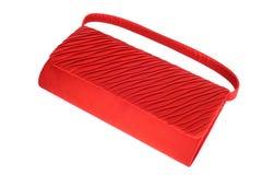 Rode dameshandtas die op wit wordt geïsoleerdc Stock Foto's