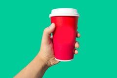 rode de koffiekop van de handgreep Royalty-vrije Stock Foto