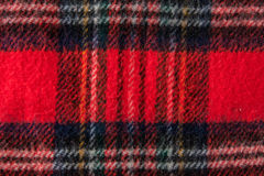 Rode de stoffen van het sjaalflanel textuur als achtergrond Stock Afbeeldingen