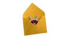 Rode dentro o envelope Imagens de Stock