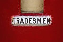 Rode deur, met tradesmen teken Royalty-vrije Stock Foto