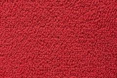 Rode dichte omhooggaand van de tapijtoppervlakte royalty-vrije stock afbeelding