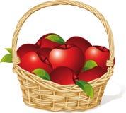 Rode die appelen in een mand op wit wordt geïsoleerd Stock Afbeeldingen