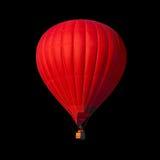 Rode die luchtballon op zwarte wordt geïsoleerd stock foto