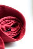 Rode die ontwerpstropdas met witte achtergrond wordt gerold Royalty-vrije Stock Foto