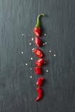 Rode die Spaanse peperpeper in plakken wordt gesneden Stock Afbeeldingen