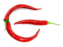 Rode die Spaanse peperpeper zoals van machtsteken wordt geschikt op witte achtergrond abstracte conceptenfoto Stock Afbeeldingen