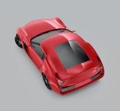 Rode die sportwagen op grijze achtergrond wordt geïsoleerd Royalty-vrije Stock Foto