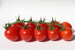 Rode die tomaten op witte achtergrond worden geïsoleerd royalty-vrije stock foto