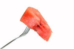 Rode die watermeloen op een vork wordt gespietst Stock Afbeelding