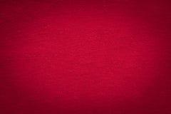 Rode doektextuur met zwart gradiëntvignet, Kerstmis en va Royalty-vrije Stock Foto