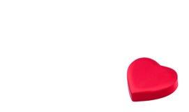 Rode doos in hartvorm Stock Afbeelding