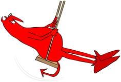 Rode duivel op een schommeling Stock Fotografie