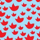 Rode eenvoudige vogels op de lichtblauwe achtergrond Royalty-vrije Stock Afbeelding