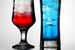 Rode en blauwe cocktails Stock Afbeelding