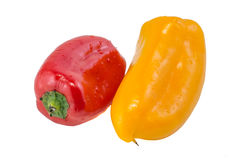 Rode en gele paprika op witte achtergrond Stock Foto