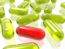 Rode en gele pillen Stock Afbeeldingen