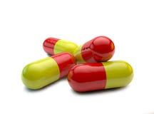 Rode en gele pillen, antibiotica stock foto's