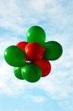 Rode en Groene Ballons Stock Afbeelding