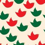 Rode en groene eenvoudige vogels op de beige achtergrond Royalty-vrije Stock Foto's