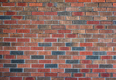 Rode en oranje bakstenen muurachtergrond Royalty-vrije Stock Afbeeldingen