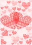 Rode en roze harten in een geruit patroon Stock Foto