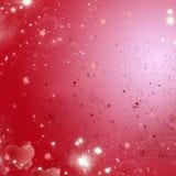 Rode en roze lichte vakantieachtergrond royalty-vrije stock foto's