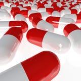 Rode en witte pillen Stock Afbeelding