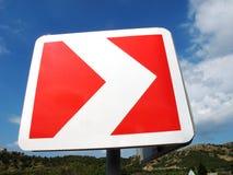 Rode en witte wijzer op de weg Stock Foto's