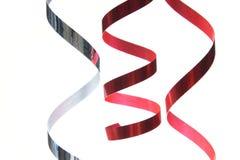 Rode en zilveren linten Stock Foto