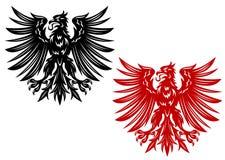 Rode en zwarte wapenkundeadelaars Stock Afbeelding